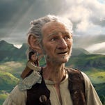 """Ruby Barnhill stars in """"The BFG"""" with the Big Friendly Giant from Giant Country, voiced by Mark Rylance."""