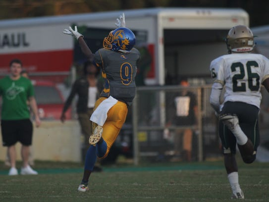 Rickards quarterback Marcus Riley fires deep for a
