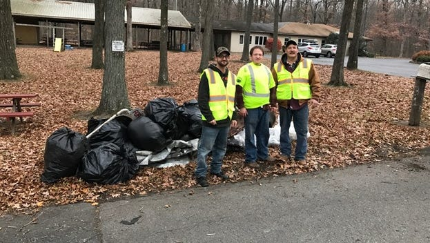 Mike Criscitiello, Josh Serlenga and Dan Serlenga were among the members of the Croton Rod & Gun Club who participated in a fall roadside cleanup recently.