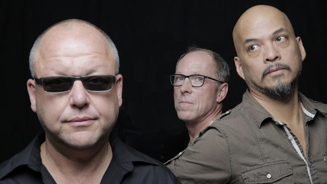 Pixies (from left, Black Francis, David Lovering and Joey Santiago) performed Saturday at Old National Centre.