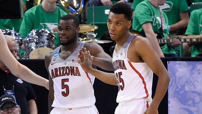 March 16, 2017; Salt Lake City, UT, USA; Arizona Wildcats guard Kadeem Allen (5) and Arizona Wildcats guard Allonzo Trier (35) react against the North Dakota Fighting Hawks during the first half in the first round of the NCAA tournament at Vivint Smart Home Arena.