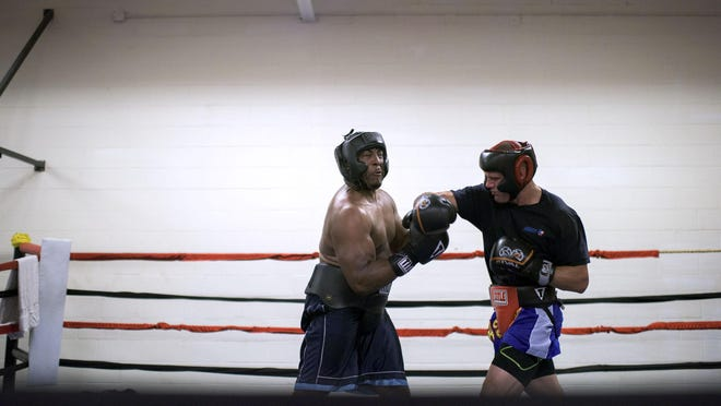 Tim Williams, right, lands a hit on Quian Davis, while sparring on July 10 in Vineland.