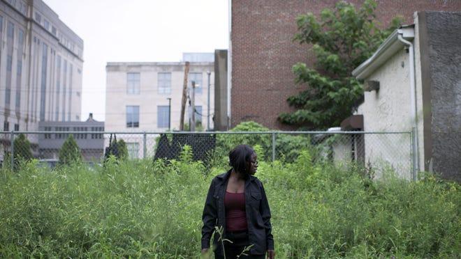 Senior Aisha Dorley, 20, walks through the ecosystem looking for new developments.