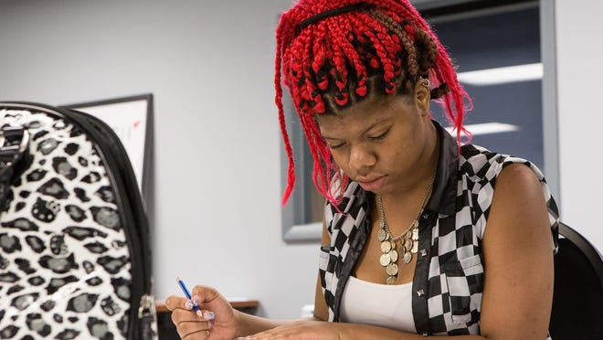 Branesha Reid, 18, of Pocomoke City takes her GED class placement test at Wicomico Public Library.