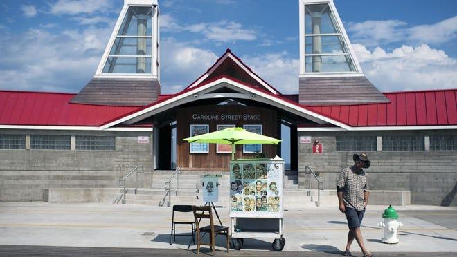 Caricature artist Mike Moeller awaits customers on the Ocean City Boardwalk last month.
