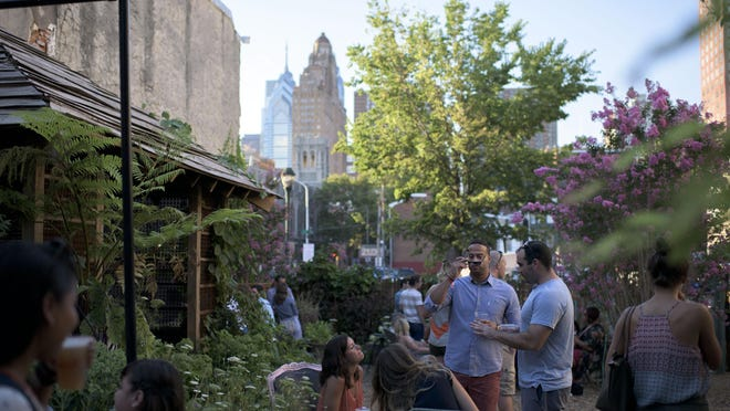 The Philadelphia Horticultural Society's pop-up garden on South Street features a view of the Philly skyline.