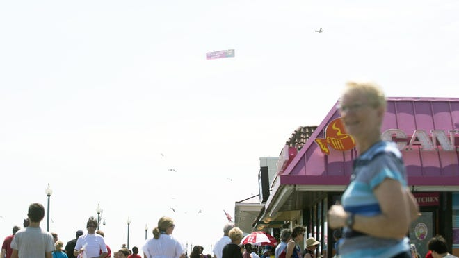 The Rehoboth Beach Boardwalk bustles with beachgoers Labor Day weekend 2014. This year was no exception.