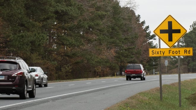 A sign marks the intersection of Sixty Foot Road and Route 50 near Pittsville.