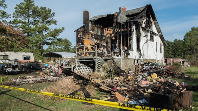 An exterior view of a house damaged by fire on Johnson Creek Road in Crisfield on Sunday, Oct. 30, 2016.