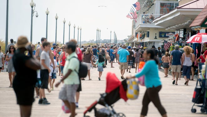 The Rehoboth Beach boardwalk bustles with beachgoers Labor Day weekend.