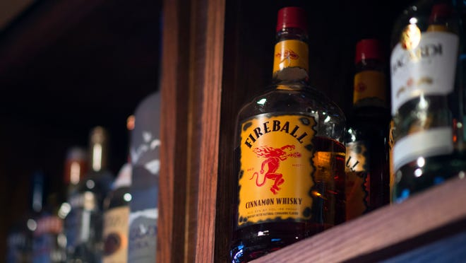 A bottle of Fireball cinnamon whisky atop a shelf at Buxy's Salty Dog Saloon in Ocean City.