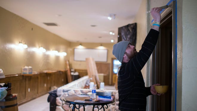 Gary Benner, a cook at The Shark, helps paint the interior of Culture on Wednesday, March 4 in West Ocean City.