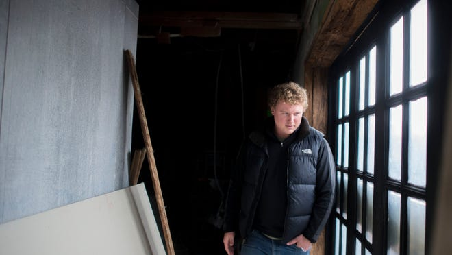 Dewey Beer and Food Co. owner Mike Reilly checks on the construction progress of his brewpub on Coastal Highway in Dewey Beach.
