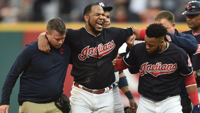 Cleveland Indians designated hitter Edwin Encarnacion reacts after an injury against the New York Yankees during the first inning in game two of the 2017 ALDS at Progressive Field.