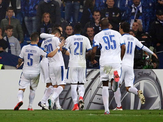 In this photo taken on Thursday, Oct. 19, 2017, Apollon's Andre Schembri, second from left, reacts after scoring during the Europa League Group E soccer match between Atalanta and Apollon Limassol, at the Mapei Stadium in Reggio Emilia, Italy. Malta national soccer team captain Andre Schembri says the car bomb slaying of a Maltese investigative journalist prompted him not to exult after scoring a historic goal. Schembri's temporary equalizer for Cypriot club Apollon in a 3-1 loss to Italian side Atalanta in the Europa League on Thursday made him the first Maltese player to score in proper European competition, excluding qualifying. (AP Photo/Elisabetta Baracchi)