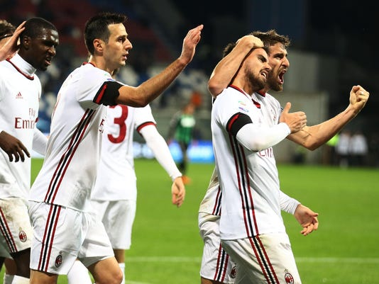 AC Milan's Suso's, second from right, celebrates after scoring during a Serie A soccer match between Sassuolo and AC Milan at the Mapei Stadium in Reggio Emilia, Italy, Sunday, Nov. 5, 2017. (Elisabetta Baracchi/ANSA via AP)