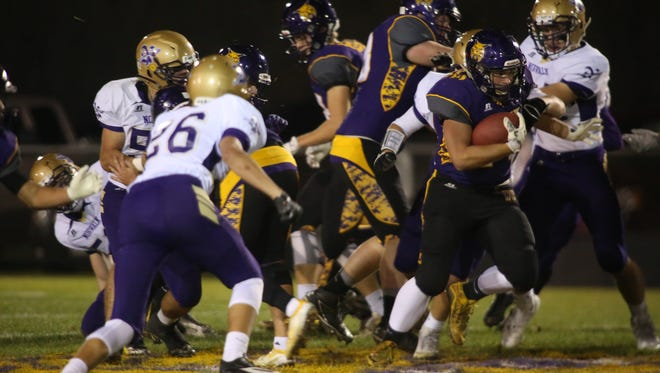 Webster City senior running back Robert Fredericksen finds a seam in the Norwalk defense. Webster City beat Norwalk 33-14 Oct. 28 in the first round of the Class 3A playoffs in Webster City.