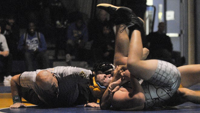 Sussex Central's Johnny Morris gets the pin against Cape's Jonah Robertson in the 220-pound division on Wednesday in Georgetown.