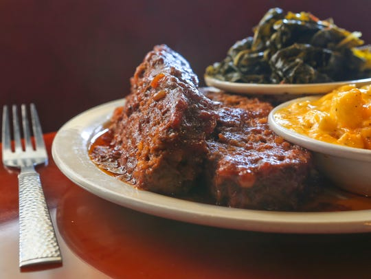 Meatloaf with mac and cheese and collard greens from