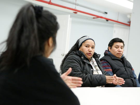 Mamaroneck resident Marta Caraballo, center, and Jose Luis Lopez, right, talk to Janet Rolon, left, at the Community Resource Center in Mamaroneck. The center and local residents helped draft a proposed law allowing undocumented immigrants in the state to get driver's license s.
