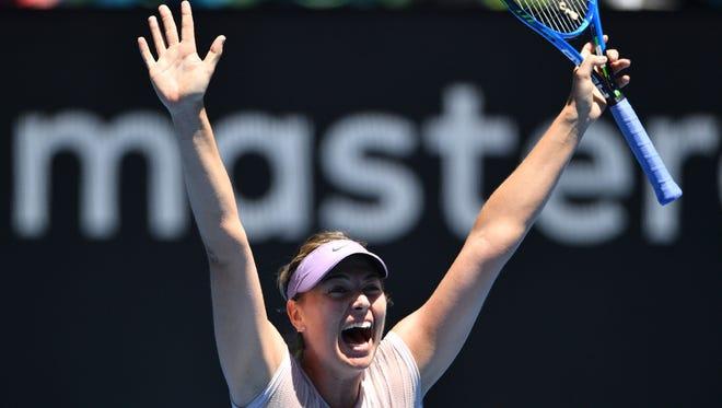 Russia's Maria Sharapova celebrates beating Latvia's Anastasija Sevastova in their women's singles second round match on day four of the Australian Open tennis tournament in Melbourne on Jan. 18.