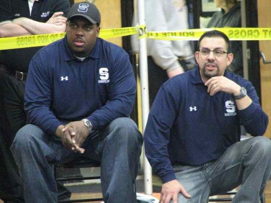 Southfield High wrestling coaches Vernon Burden, left,