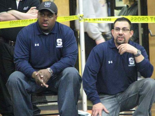 Southfield High wrestling coaches Vernon Burden, left, and Carl Barnes at a meet.