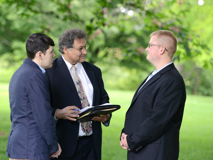 Jorge Gonzalez (left) and Lee Nichols get married at Bush's Pasture Park in Salem on Monday, May 19, 2014. Gonzalez and Nichols were the first gay couple to apply for a marriage license in Marion County. Marion County Clerk Bill Burgess officiated.