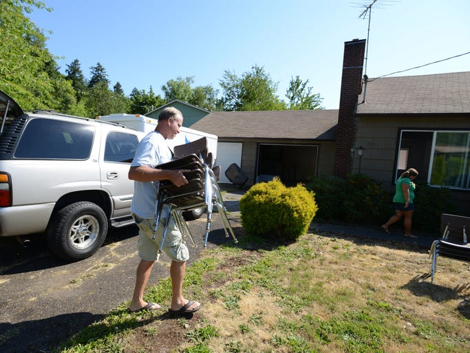 Craig Oviatt unloads chairs at Nuestra Casa in West Salem on Wednesday, July 16, 2014. The Dream Center just signed a lease with West Salem Baptist Church for Nuestra Casa, a community house with space for a garden, classes, a library and children's activities.