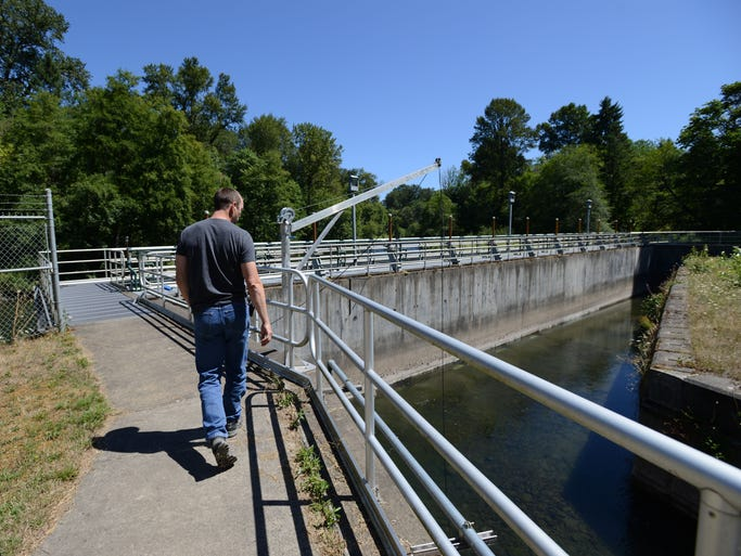 Tim Sherman, operations and maintenance supervisor at the Geren Island Water Treatment Facility, shows the middle intake area, which is the first filtration step. Photographed on Thursday, Aug. 7, 2014.