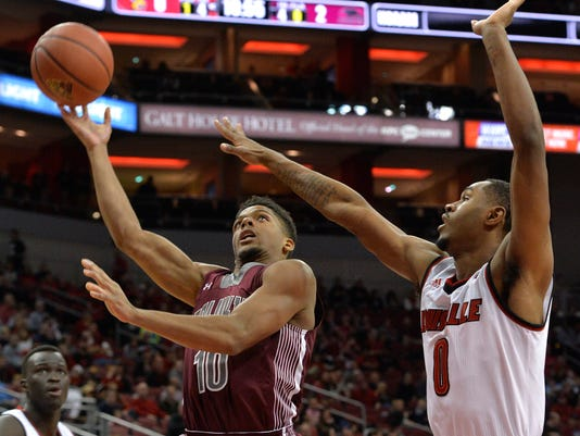 Southern Illinois guard Aaron Cook (10) attempts a shot over the defense of Louisville forward V.J. King (0) during the first half of an NCAA college basketball game, Tuesday, Nov. 21, 2017, in Louisville, Ky. (AP Photo/Timothy D. Easley)