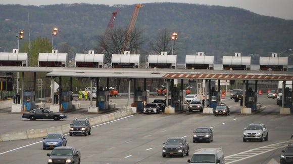 Drivers go through the unmanned toll plaza on the now-cashless Tappan Zee Bridge, April 25, 2016.