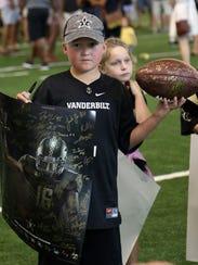 Vanderbil fan Landon Reynolds collects autographs during