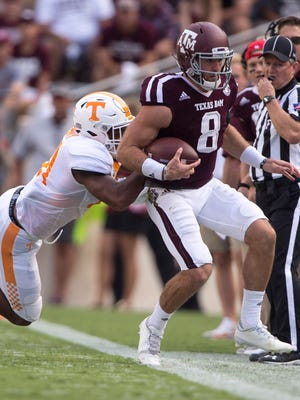 Texas A&M Aggies quarterback Trevor Knight (8) is pushed out of bounds by Tennessee Volunteers linebacker Jalen Reeves-Maybin (21) during the second quarter at Kyle Field.