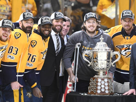 The Predators  celebrate with the Campbell Trophy after