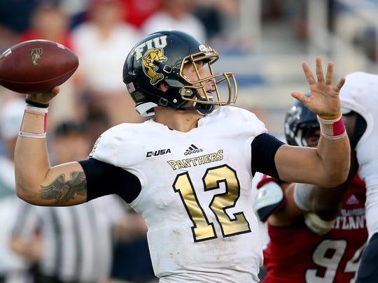 Golden Panthers quarterback Alex McGough (12).