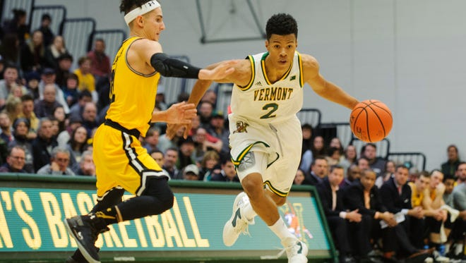 Vermont's Trae Bell-Haynes (2) will continue his basketball career overseas, signing with a German professional team.
