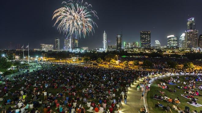 Thousands watch the July 4, 2015, firework show over downtown Austin from Vic Mathias Shores. The Austin Symphony Orchestra canceled this year's concert and fireworks show over concerns about the spread of the coronavirus.