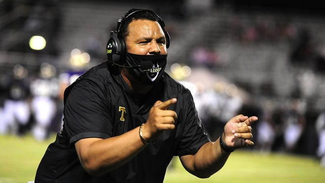 Thomson Head Coach Michael Youngblood barks ordes to his players Friday night at the high school football game between Thomson and ARC on October. 16, 2020 in Augusta, Ga.