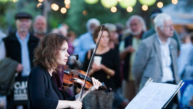 "Patricia Kopatchinskaja plays the Luigi Nono piece, ""La lontananza nostalgica utopica futura,"" in Libbey Park on Thursday, the opening night of the Ojai Music Festival. Kopatchinskaja is the festival's music director."