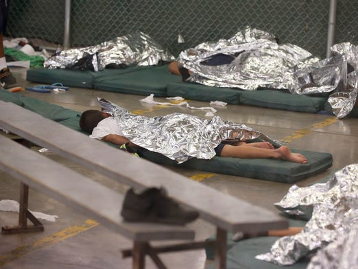 Young boys sleep in a holding cell U.S. Customs and