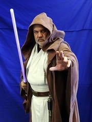 "Tony Grove, owner of Tony's Kingdom of Comics, dresses as Obi-Wan Kenobi from ""Star Wars."""
