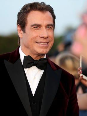 The correct response: Who isJohn Travolta?