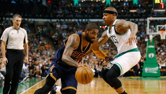 May 19, 2017; Boston, MA, USA; Cleveland Cavaliers guard Kyrie Irving (2) drives against Boston Celtics guard Isaiah Thomas (4) during the first half in game two of the Eastern conference finals of the NBA Playoffs at TD Garden.