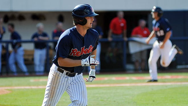 Mississippi's Auston Bousfield watches his game winning hit, which scored teammate Holt Perdzock, against Georgia at Oxford-University Stadium in Oxford, Miss. on Sunday, May 11, 2014.