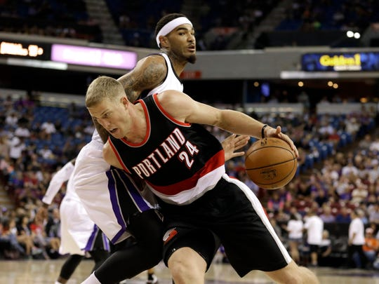 Portland Trail Blazers center Mason Plumlee (24) drives past Sacramento Kings center Willie Cauley-Stein during the first quarter of an NBA basketball game in Sacramento, Calif., Saturday, Oct. 10, 2015.