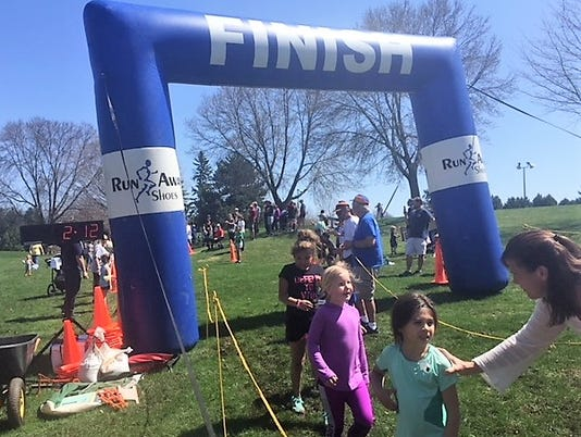 636614840847131431-Youth-Run-Finish-Line.jpg