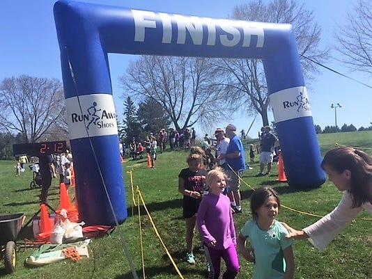636614840847131431-Youth-Run-Finish-Line.jpg