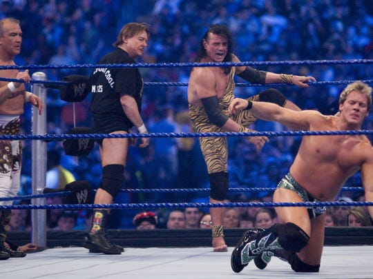 """Jimmy """"Superfly"""" Snuka, center, steps into the ring to battle WWE superstar Chris Jericho during WrestleMania 25 in 2009."""