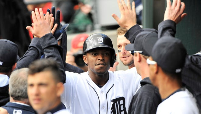 Justin Upton collects a few high-fives in the dugout after his homer in the first inning.